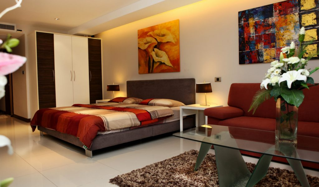 Amazing Design Of The Studio Apartment Layout With White Floor Ideas Added With Red Sofa And Floral Rugs Ideas