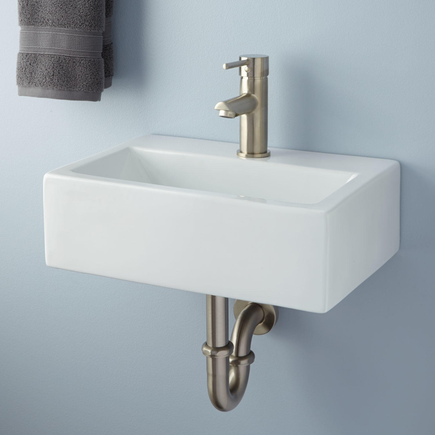 Amazing Design Of The Wall Mounted Sink With White Marble Color Materials  Added With Silver Faucets