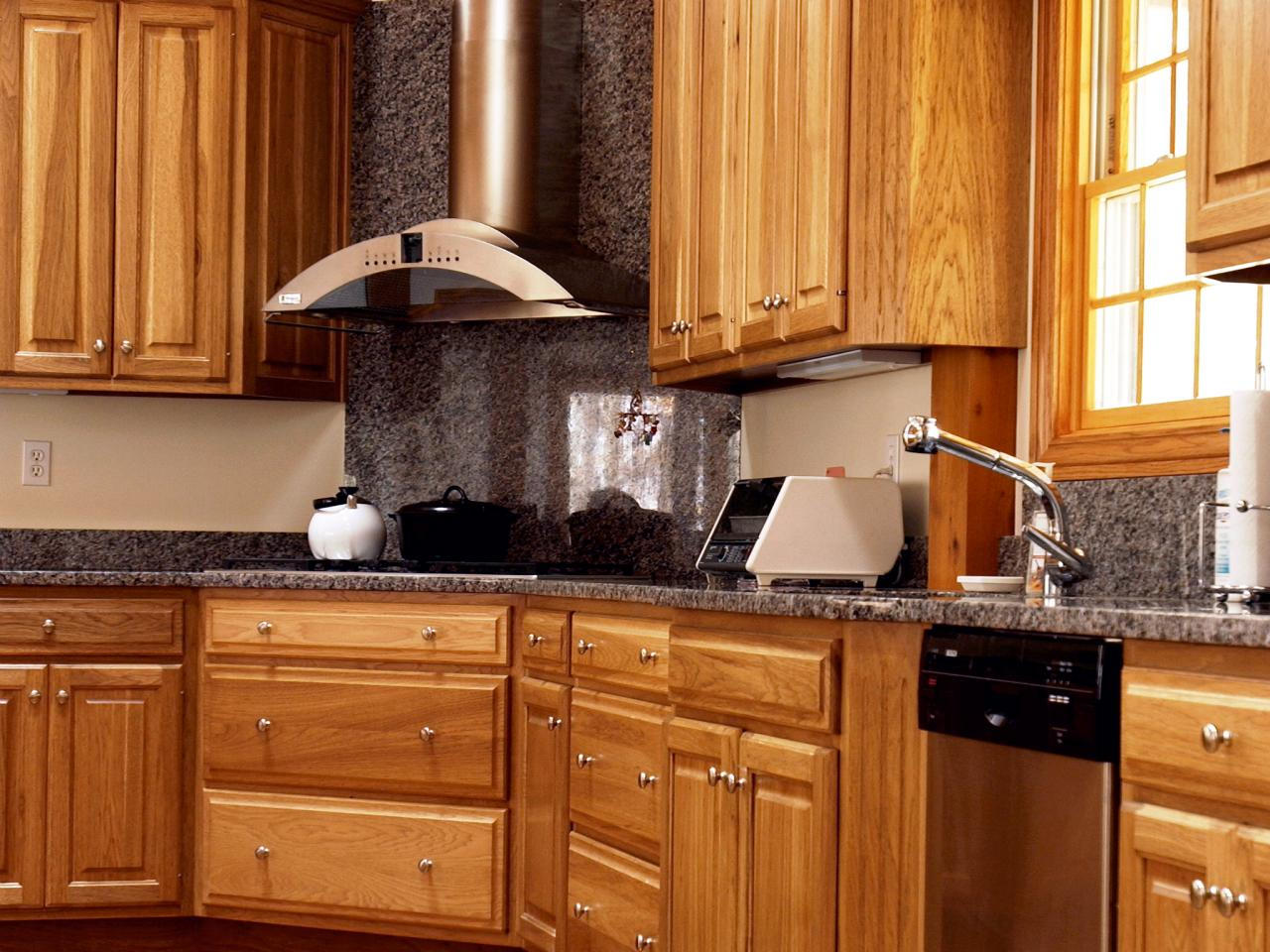 Amusing Design Of The Wood Kitchen Cabinets With Black Marble Backsplash Added With Silver Sink Ideas