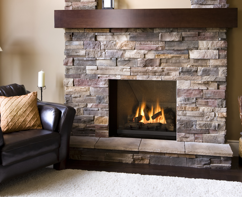 Angelic Living Space With Fireplace Stone Veneer Beside Dark Leather Arm Chair