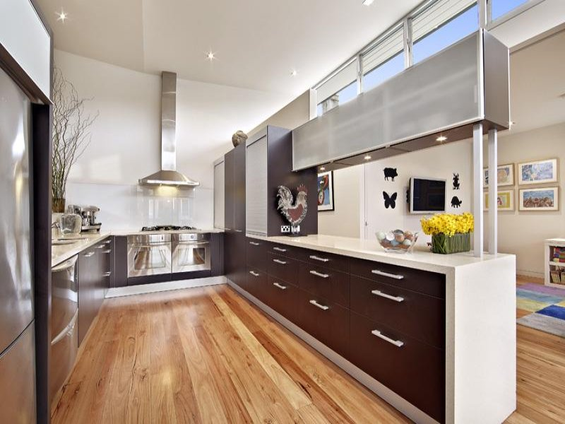 Astonishing Design Of The Kitchen Areas With Brown Floor Ideas Added With Black Wooden Cabinets And White Tops Ideas