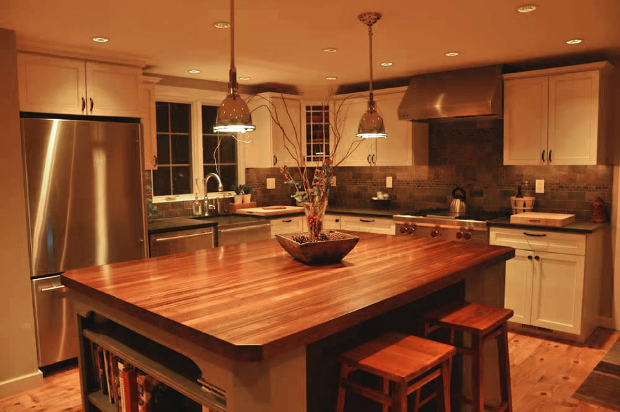 Astonishing Design Of The Kitchen Countertop Materials With Brown Wooden Table Ideas Added With Two Hanging Lamp And Brown Wooden Floor Ideas