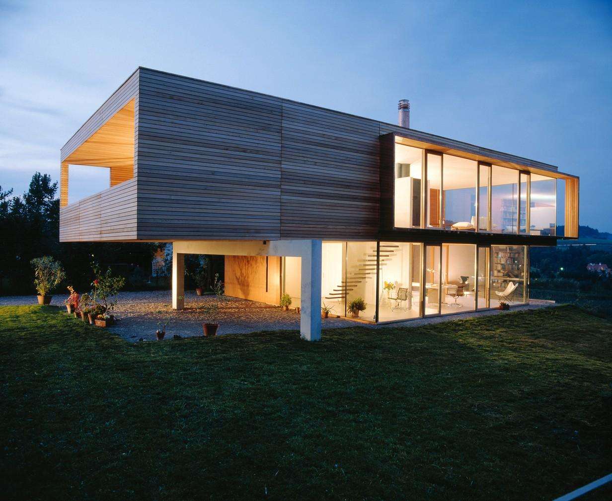 Astonishing Design Of The Modern Style Homes With Wooden Wall Added With Through Looking Glass Wall At Some Parts