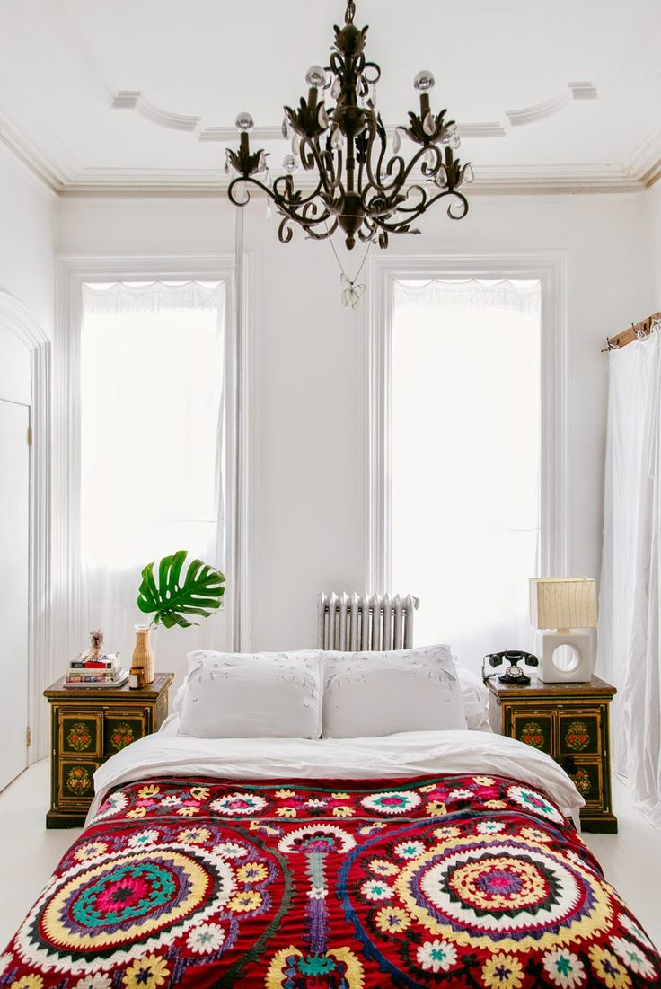 Astonishing White Wall and Floor also Dark Chandelier plus Lush Duvet