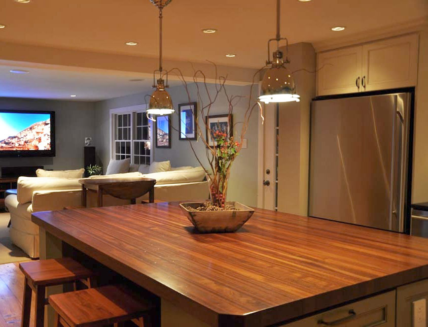 Astounding Design Of The Kitchen Countertop Materials With Brown Wooden Materials Added With Two Hanging Lamp And Brown Wooden Floor