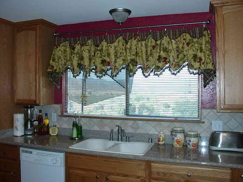 Astounding Design Of The Kitchen Curtains Ideas With Green Curtain Added With White Wall And Brown Wooden Cabinets Ideas