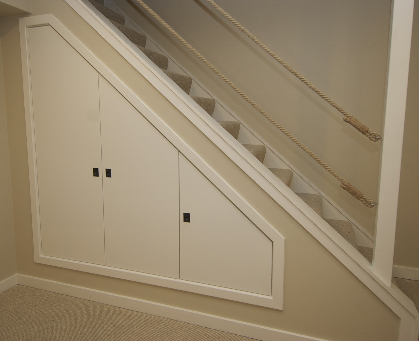 Astounding Design Of The Storage Under The Stairs With Beige Wall Ideas Added With White Wooden Wall Door Ideas