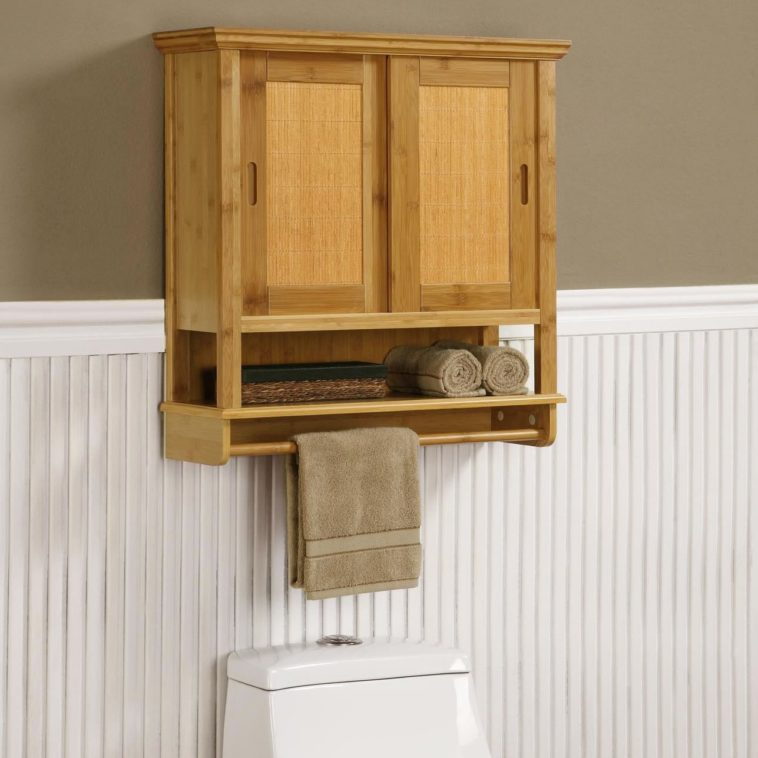 Awesome Design Of The Bathroom Cabinet Storage With Brown Oak Wooden Materials Added With Some Hook As The Place For Towel Ideas