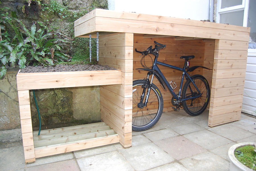 Awesome Design Of The Bike Storage Outdoor With Brown Wooden Color Materials Added With Grey Floor Ideas And White Wall Ideas