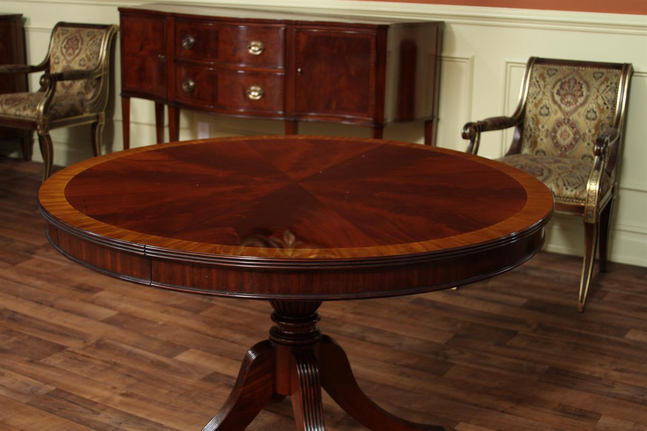 Modern round dining table a new family tradition for Round wood dining room table