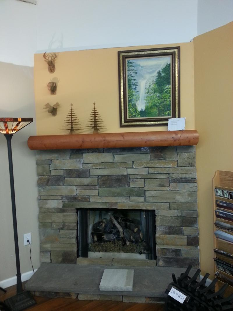 Beauty Design Of The Fireplace Stone Veneer With Brown Stone Shelf Added With A Picture On The Wall