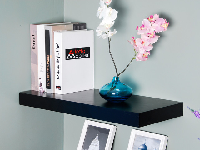 Chic Flowers On Blue Vase Near Book On Black Floating Shelves