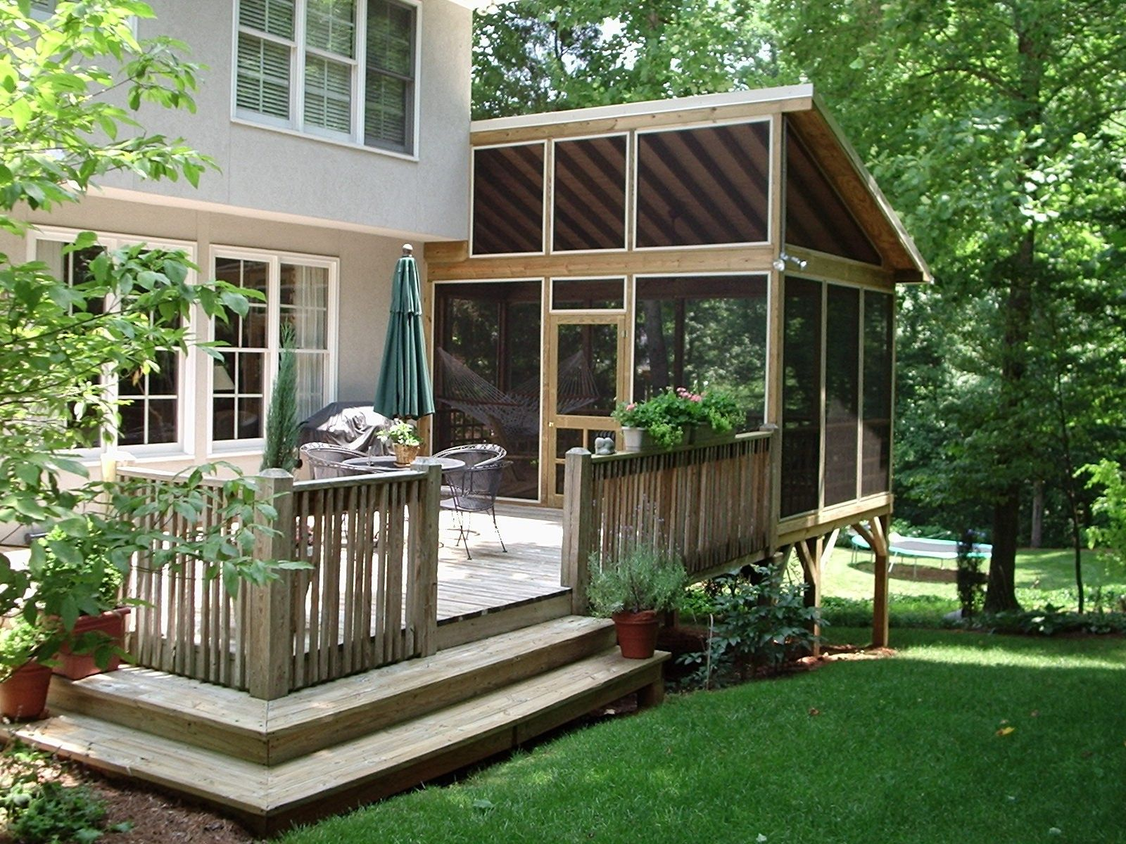 Chic Table and Chair also Umbrella For Best Backyard Deck