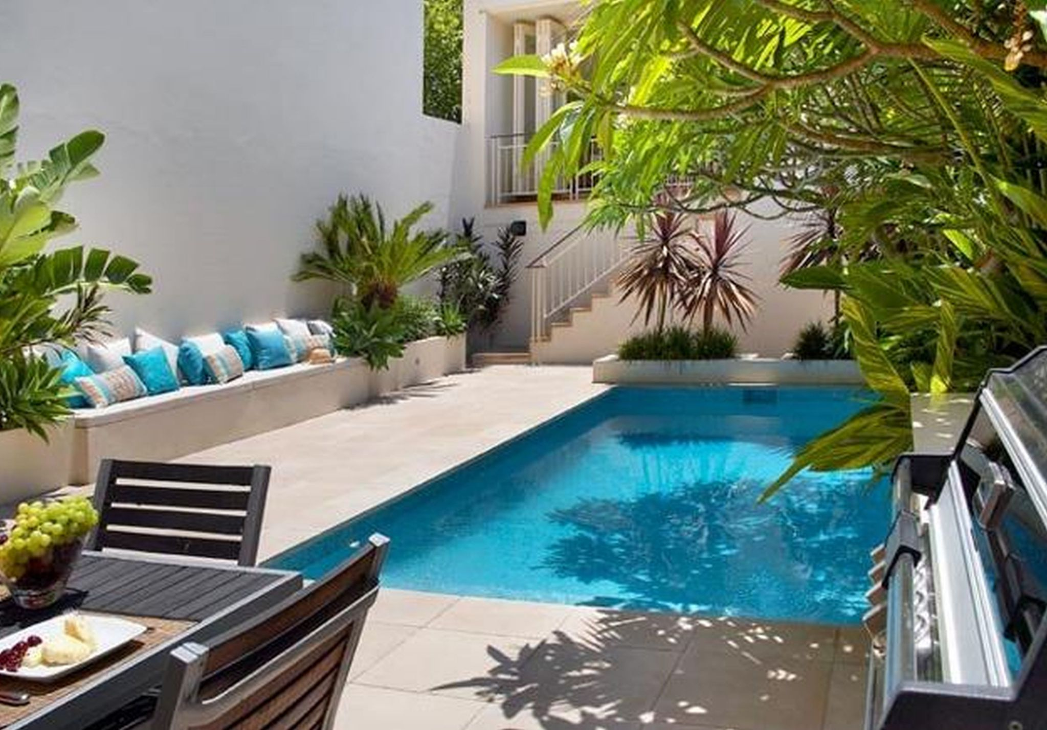 Clean Swimming Pool also Lush Seat With Pillows For Small Yard