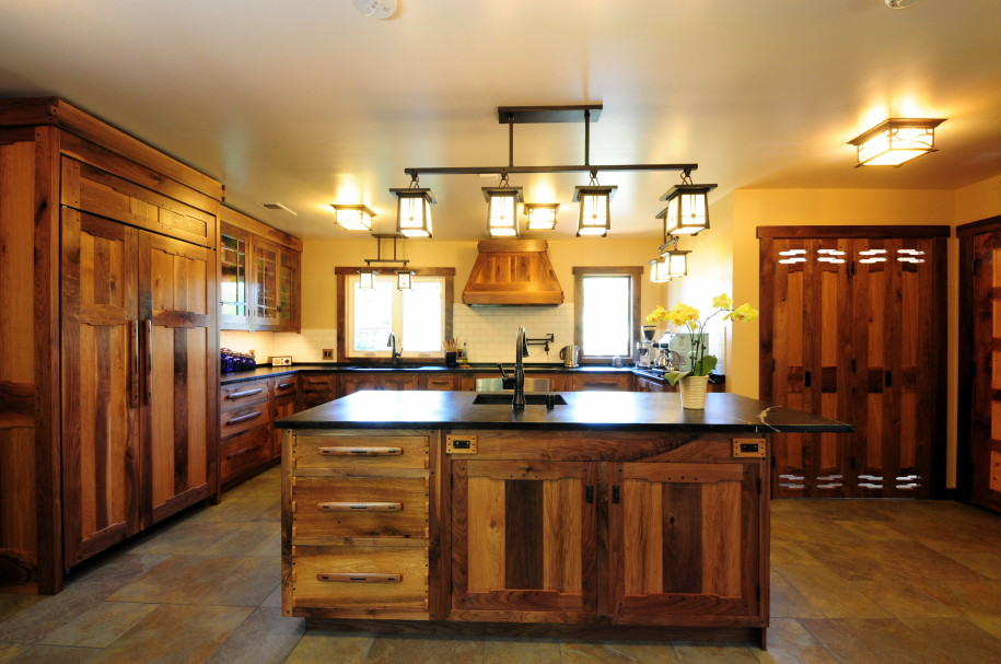 Cozy Design Of The Kitchen Decorating Themes With Brown Wooden Kitchen Island And Brown Wooden Cabinets Added With Four Hanging Lamp