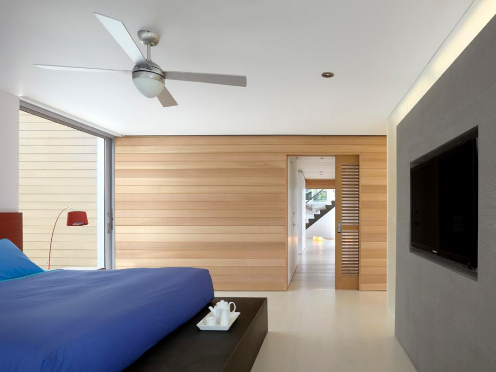 Delicate Wooden Wall Paneling Plus Ceiling Lamp Van Above Blue Bed