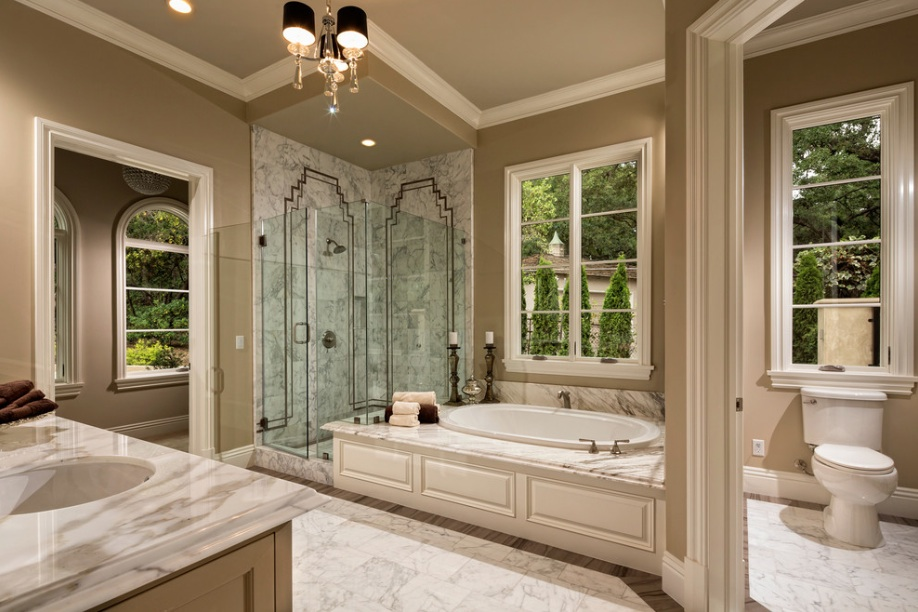 Elegant Bathroom Using Bathtub Near Window also Dark Shade Chandelier