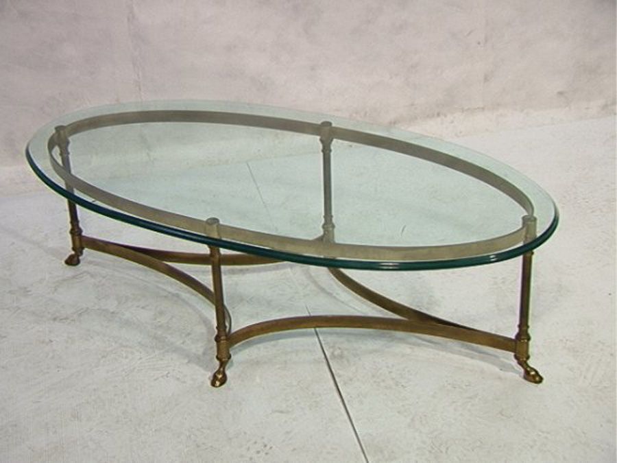 Elegant Design Of The Oval Glass Coffe Table With Bronze Iron Legs For The  Furniture Of