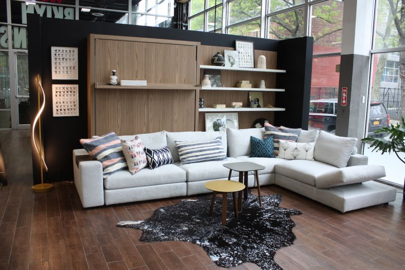 elegant living space using small scale furniture of white sectional sofa and coffee table - Small Scale Coffee Tables