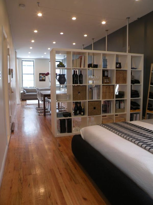Fantastic Design Of The Apartment Bedroom Ideas With Brown Wooden Floor Ideas Added With White Wooden Bookcase Separated Wall Ideas