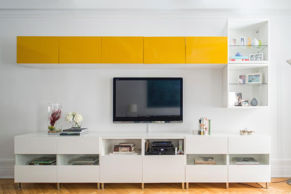 Fantastic Design of White Media Cabinet Using Chic Yellow Accent