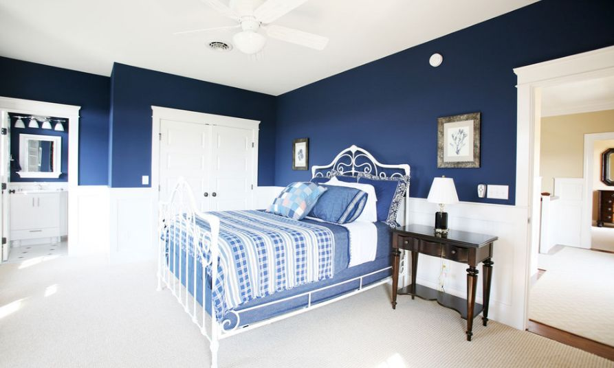 Fascinating Navy Blue Wall and Bed also Dark Wooden Table