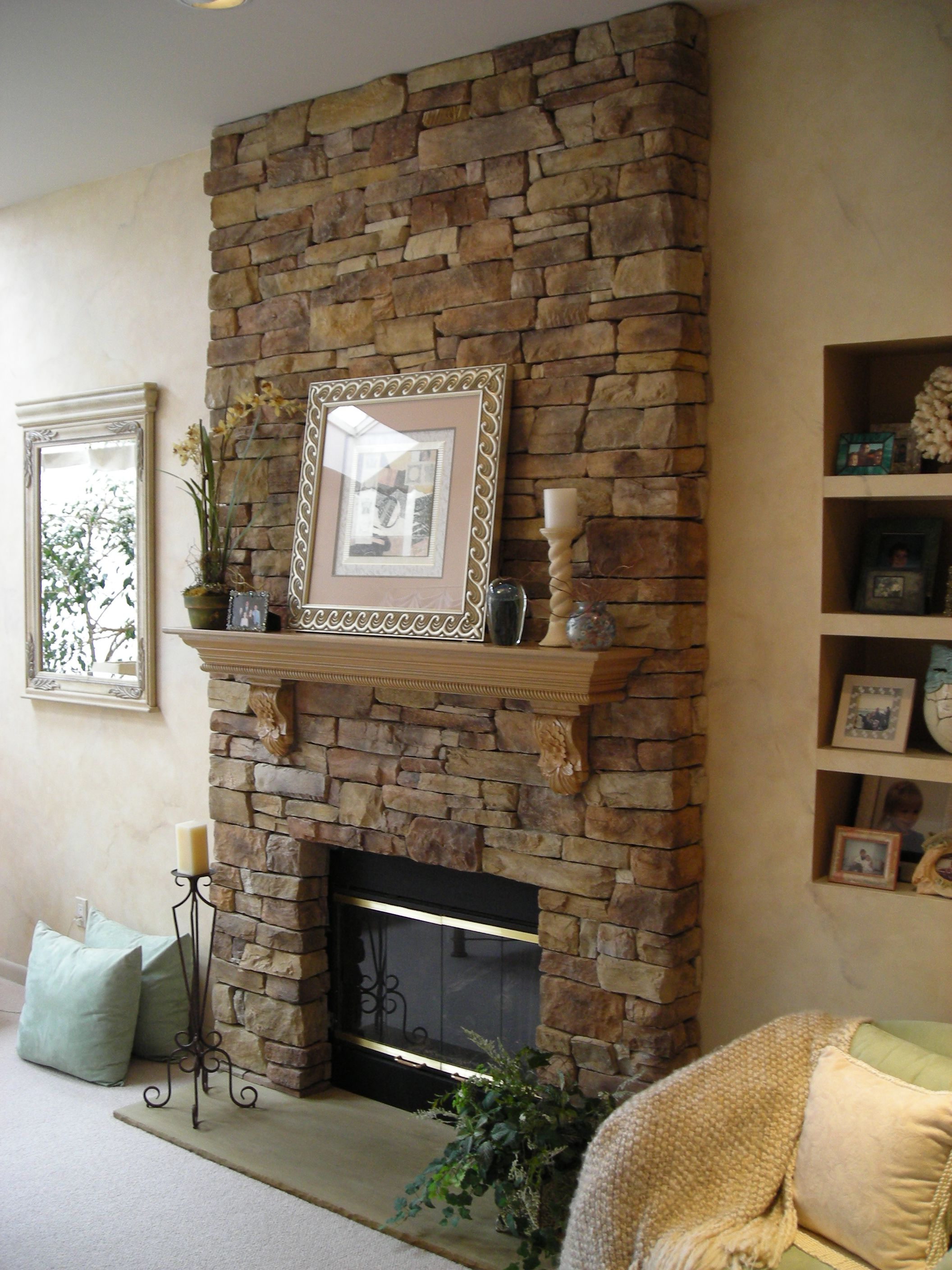 Graceful Family Room With Fireplace Stone Veneer also Wooden Shelve Design