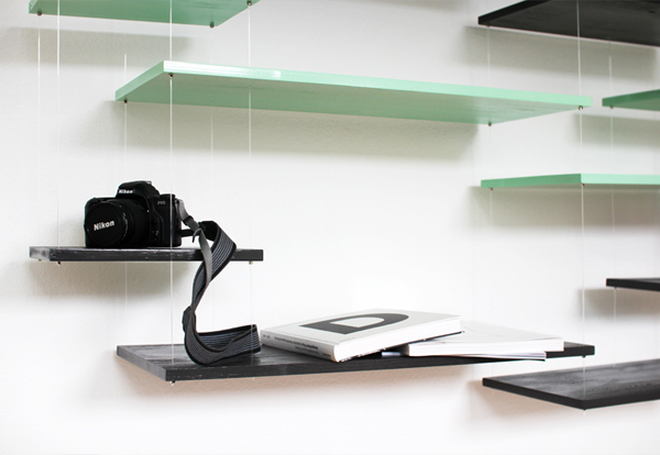 Hunky Design of Tempered Glass Shelves on Wall For Saving Camera