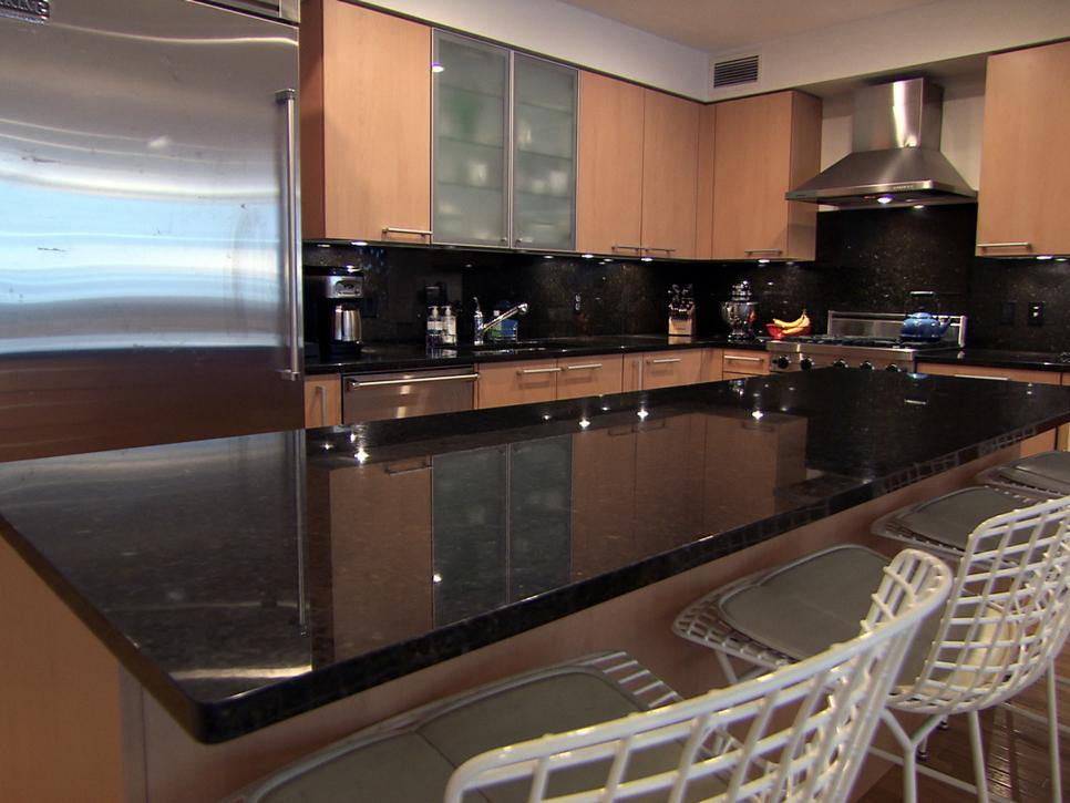 Hunky Interior Kitchen Using Dark Marble Table also Comfortable Chairs