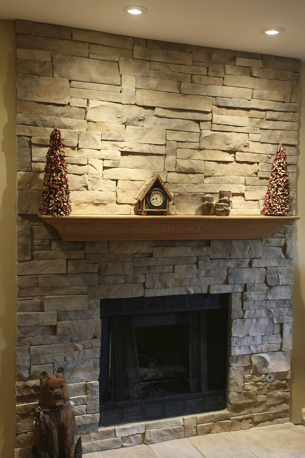 Hunky Wooden Shelve On Natural Fireplace Stone Mantel also Built In Lamps