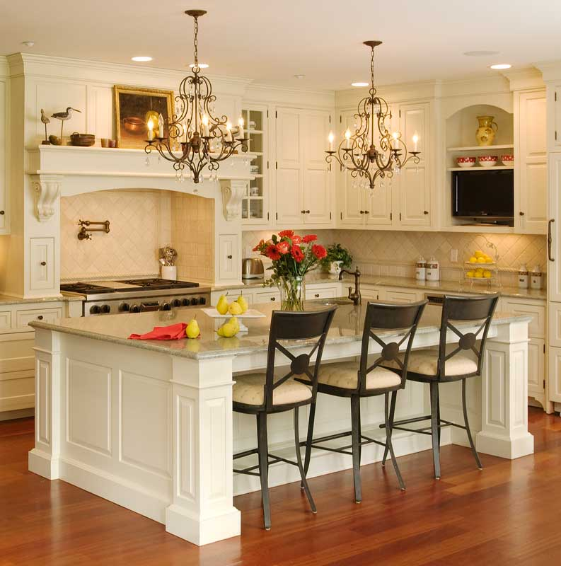 Interesting Chandeliers above Bar Table Plus Kitchen Islands With Stools