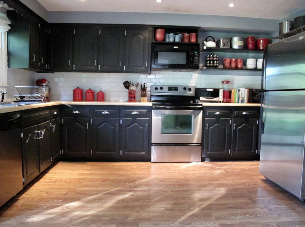Interesting Wooden Flooring also Black Cabinet Plus White Kitchen Back Splash