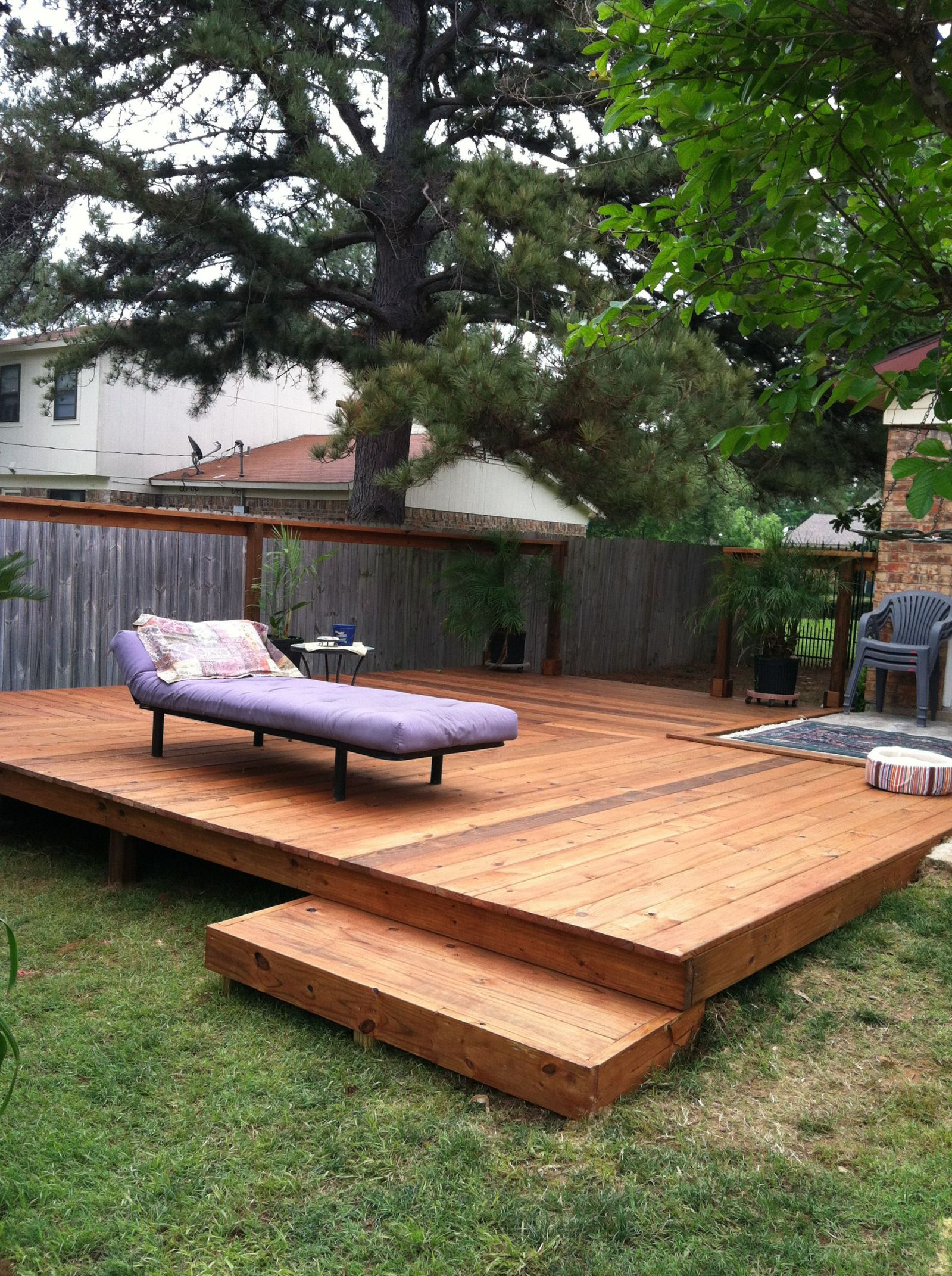 Inviting Backyard Deck Ideas With Wooden Floor Tile and Long Chair