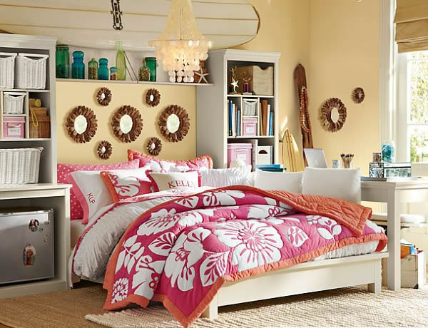 Large Bed With Flowery Cover Between Bookshelves For Girl Room Decor
