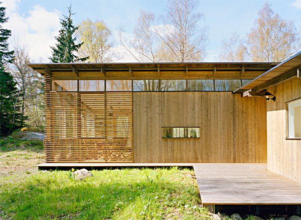 Lush Summer House Apartmets With Natural Wooden Wall and Glass Window