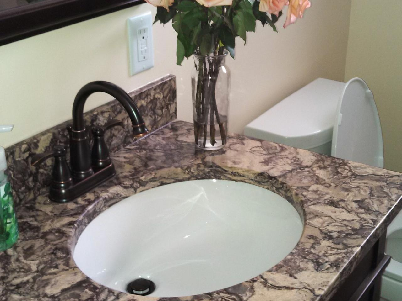 Luxurious Cabinet With Round Sink also Granite Top Plus Dark Faucets