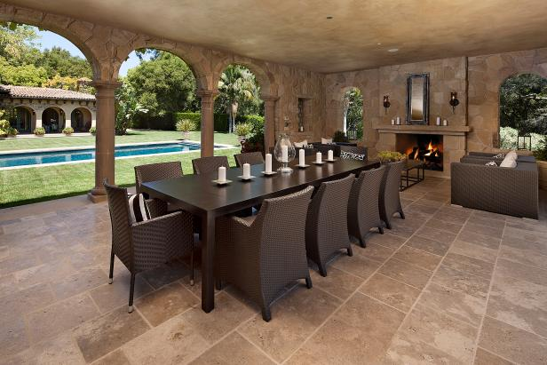 Luxurious Patio Near Pool With Sleek Wooden Dining Table and Chairs