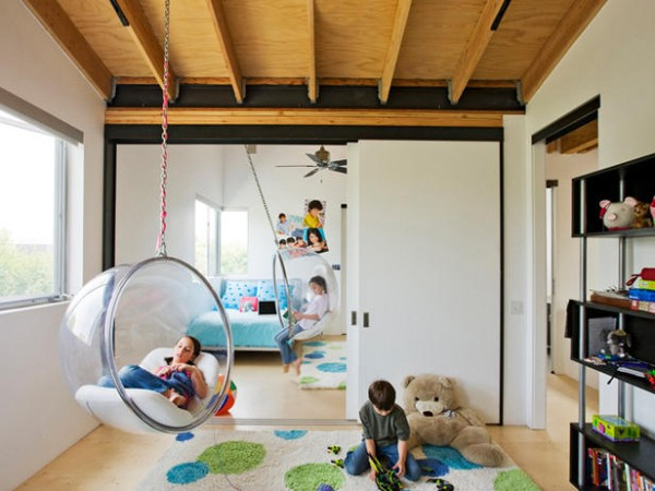 Magnificent Kids Area With Two Hanging Chairs also Book Shelve and Carpet
