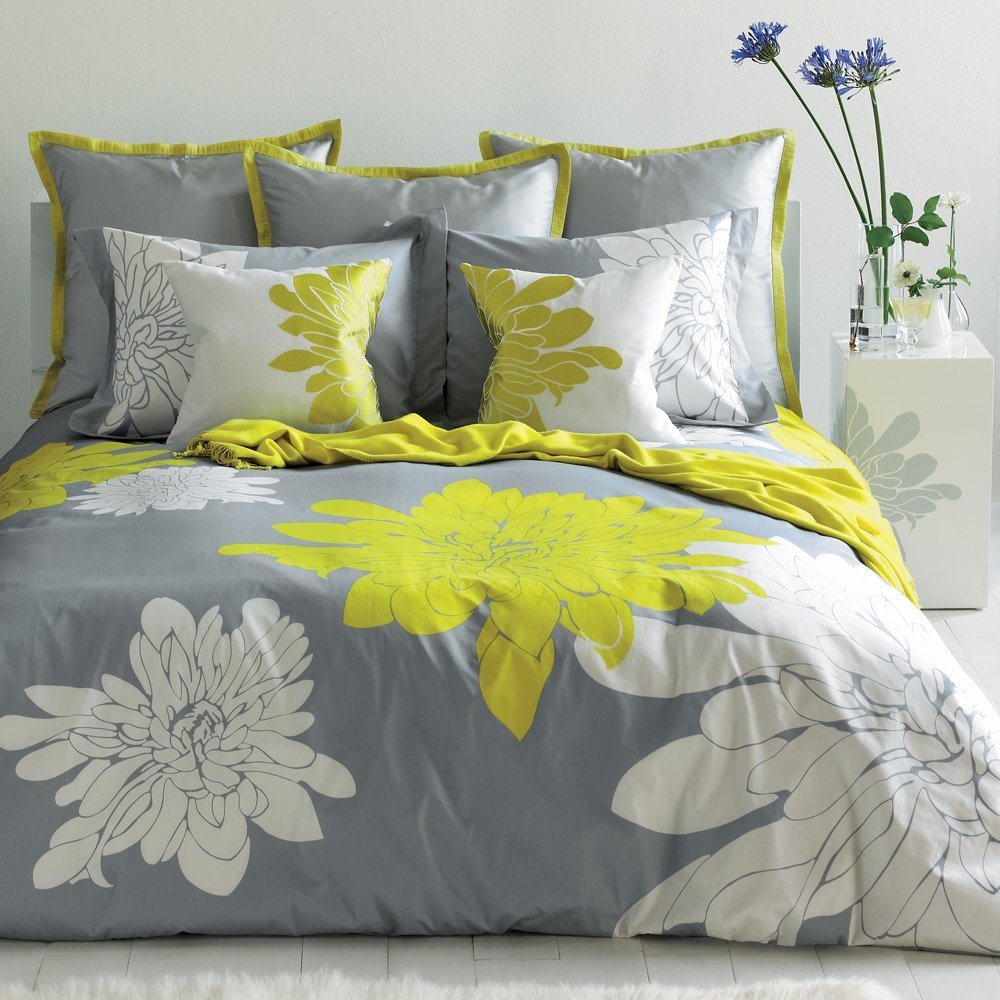 Mesmeric Bed With Flowery Cover and Pillow also Purple Fake Flower