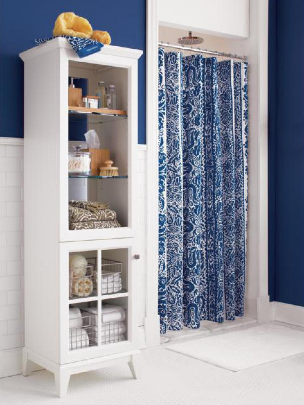 Mgnificent Bathroom Using Blue Curtain also High Shelve For Toiletries