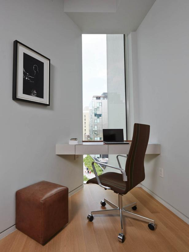 Minimalist Space Saving Desk and Office Chair Near High Window