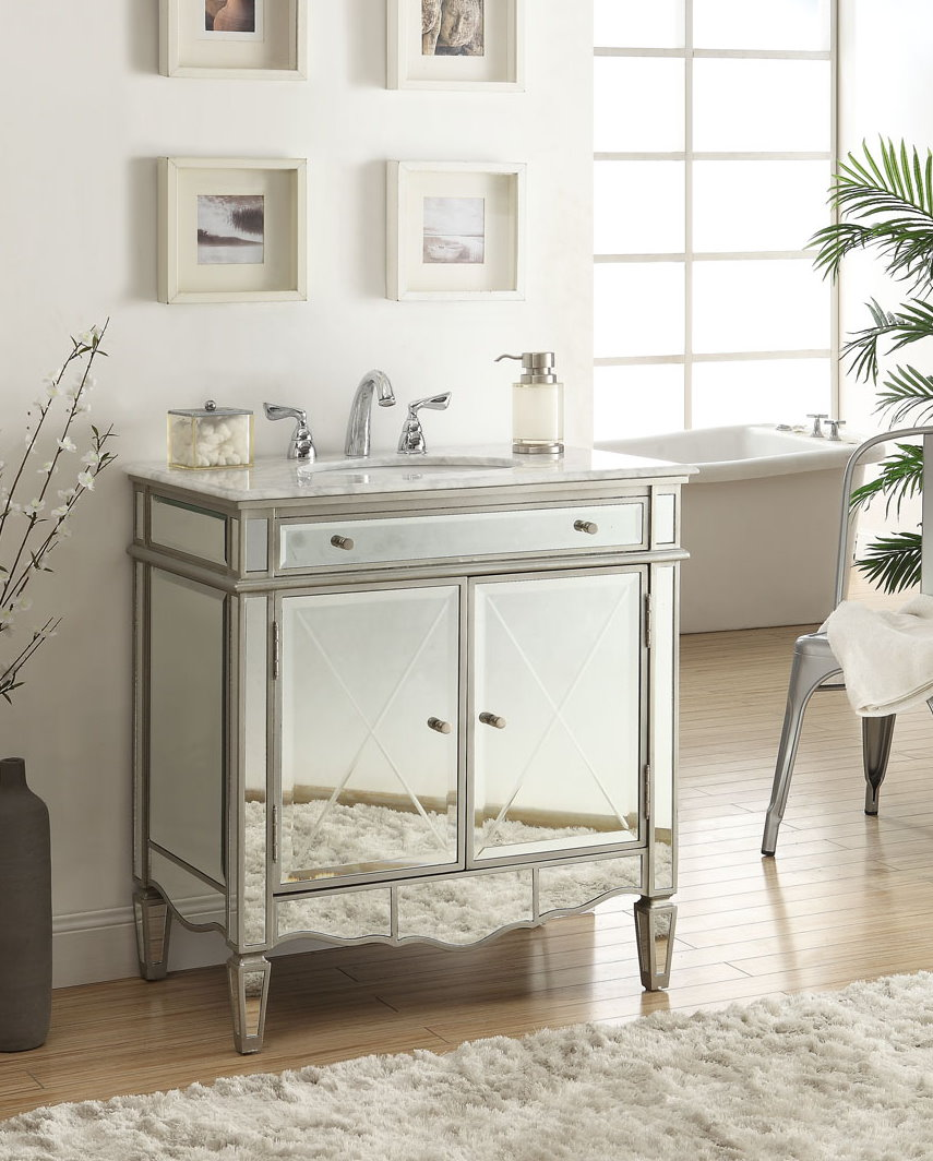 Modern Vanity With Sink and Stainless Steel Faucet Plus Nice Wall Decor