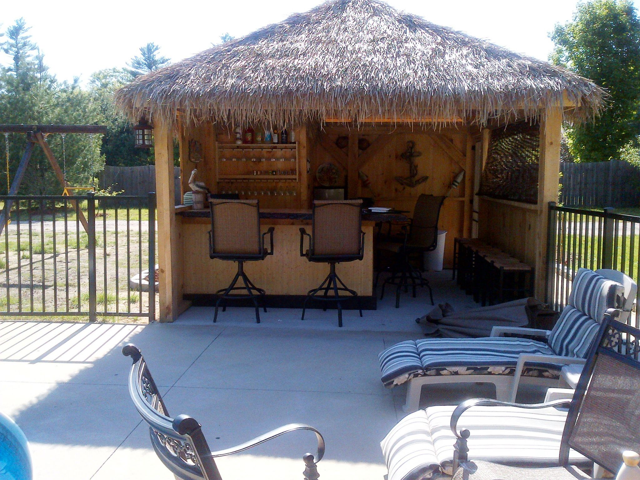 Pleasant Patio With Bar Table and Chair Plus Mounted Wine Rack