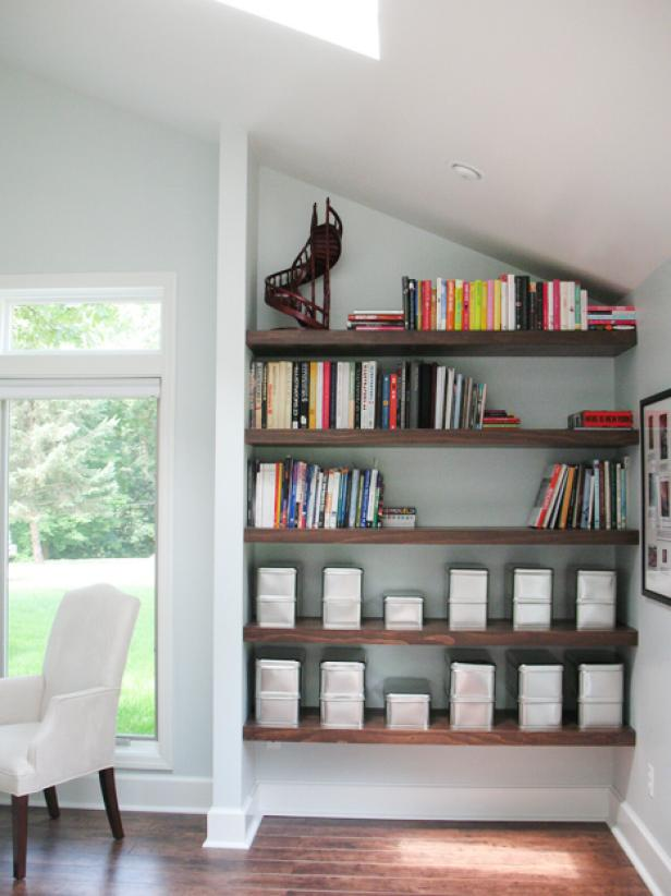 Ravishing Living Space Using Mounted Wooden BookShelve Under Slanting Ceiling