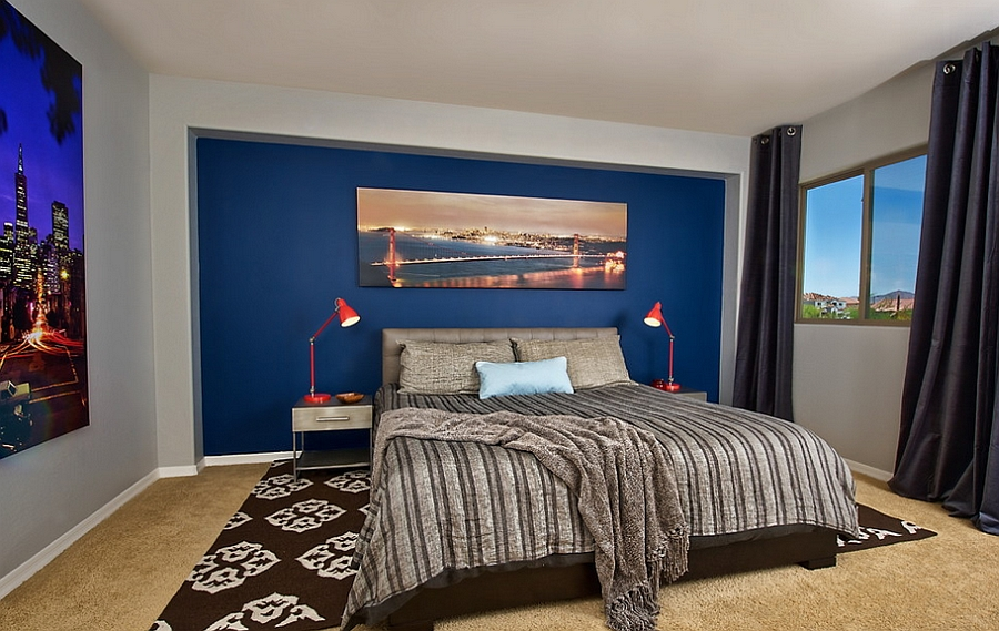 Simple Bedroom With Blue Background also Large Bed between Arch Table Lamps