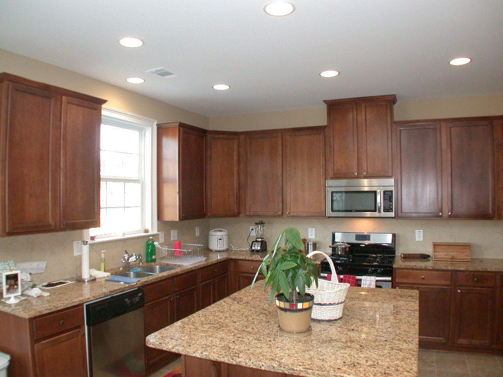Simple Kitchen Back Splash also Brown Wooden Cabinet With Granite Top