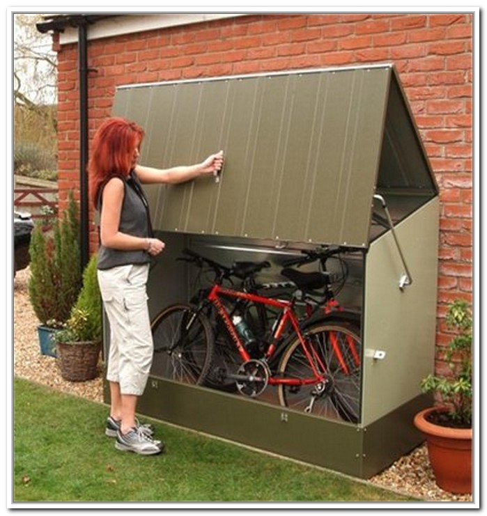 Stunning Design Of The Bike Storage Outdoor With Grey Brown Color Ideas Added With Green Grass In Front Of It