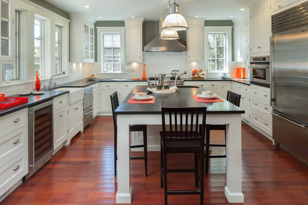 Stunning Design Of The Kitchen Areas With Brown Wooden Floor Ideas Added With White Cabinets And White Wall Ideas
