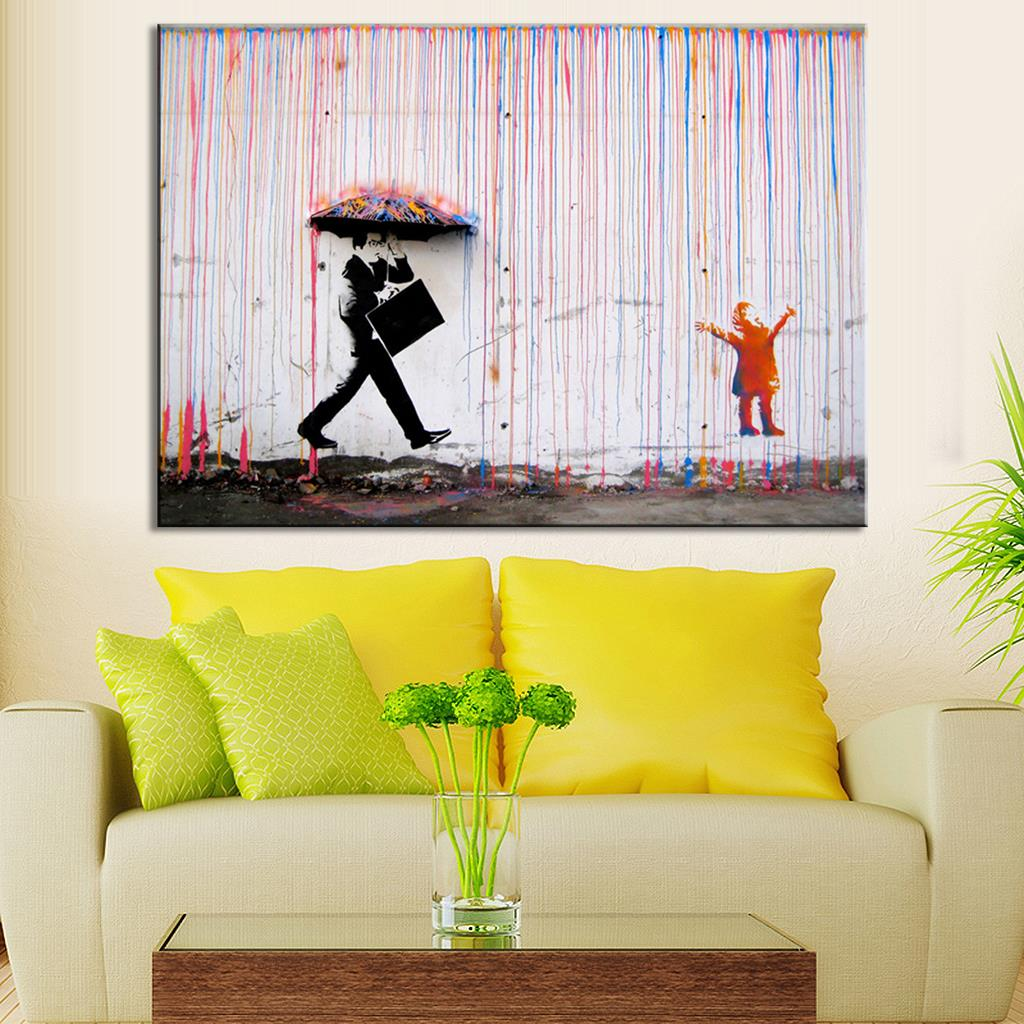 stunning design of the living room wall art with yellow pillows added