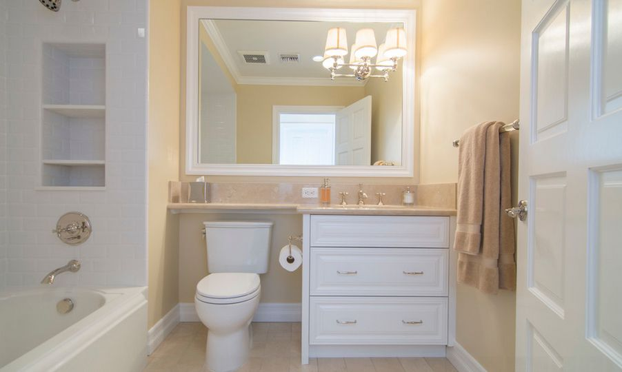Stunning Design Of The Small Bathroom Cabinets With Grey Color Added With White Wooden Frame Mirror Ideas With Wall Mounted Lamp Ideas
